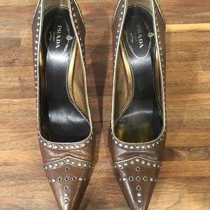 Prada brown heels with metal hardware